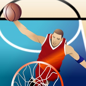 バスケットボールでダンクシュートを決める男の子
