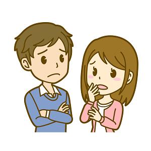 悩んで話し合いをする若い夫婦